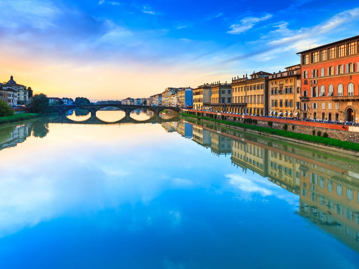 the-arno-river-runs-right-through-the-city-its-so-calm-that-youll-regularly-see-kayakers-slicing-through-the-water
