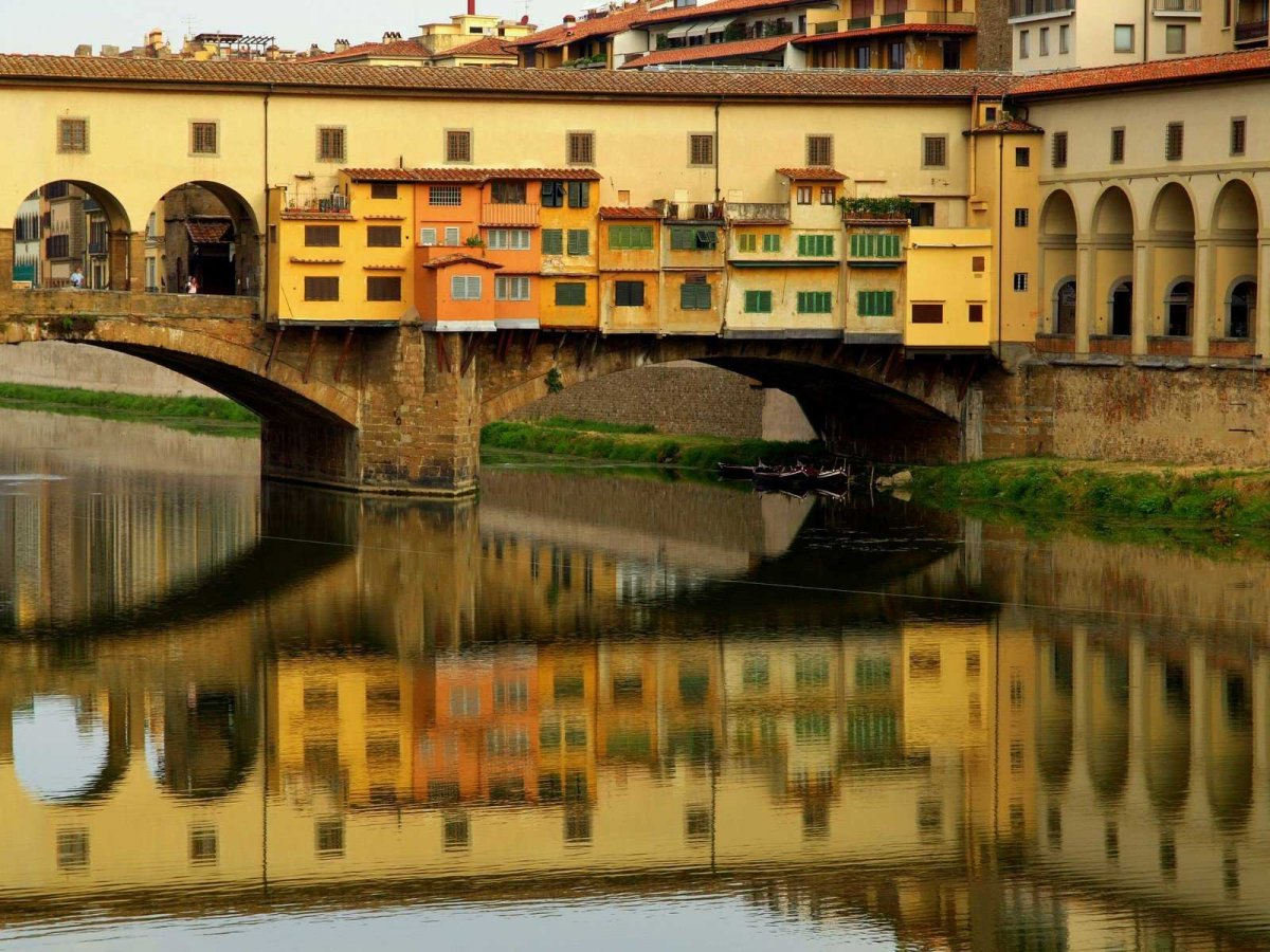 there-are-several-bridges-over-the-arno-but-the-most-famous-bridge-is-the-ponte-vecchio-a-medieval-stone-bridge-thats-covered-with-shops