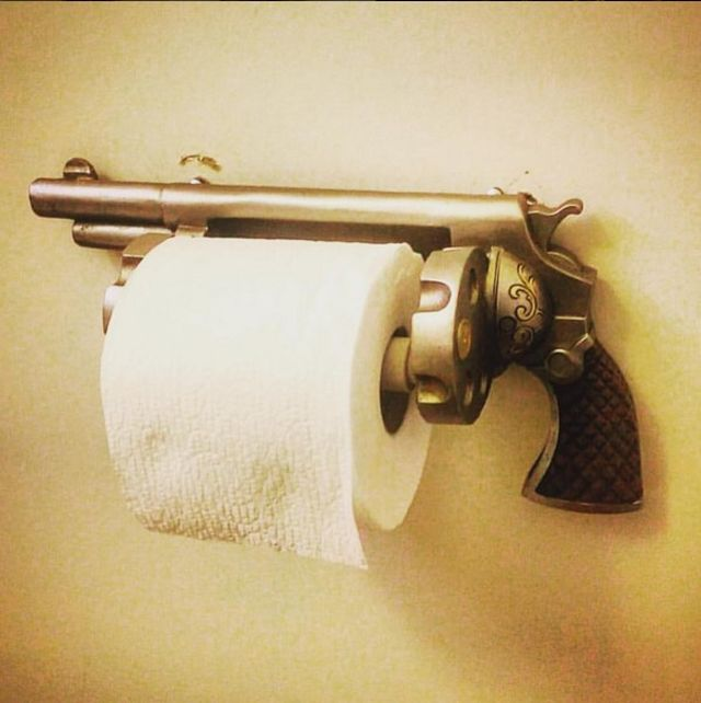 Old revolver toilet paper holder